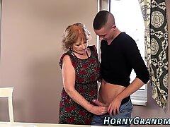 Horny granny gobbles cock