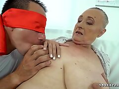 Bigtitted granny holding a hard dick
